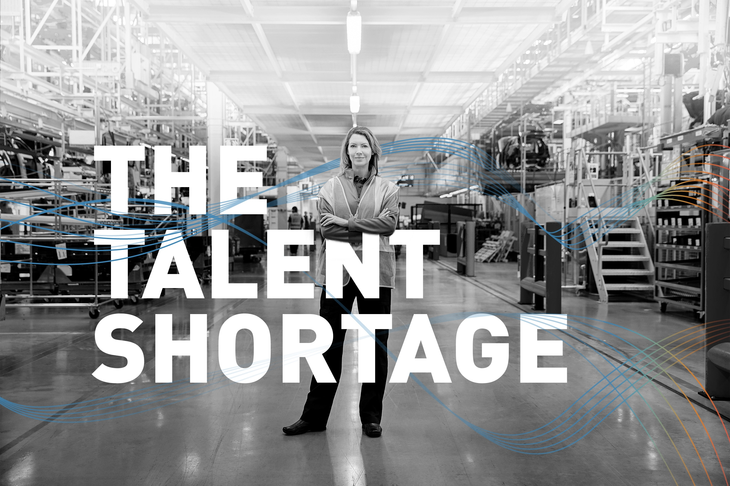 The Talent Shortage - Women standing with crossed arms in a manufacturing setting